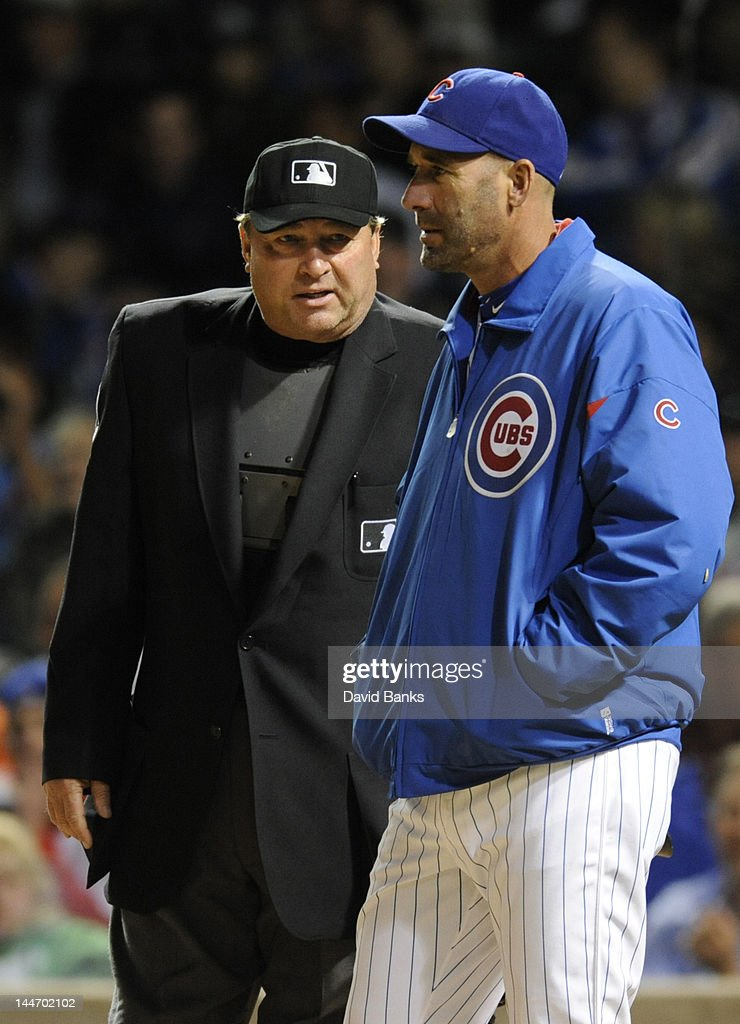 Manager Dale Sveum #33 of the Chicago Cubs questions a call with home plate umpire Gerry Davis in the eighth inning against the Philadelphia Phillies on May 17, 2012 at Wrigley Field in Chicago, Illinois.