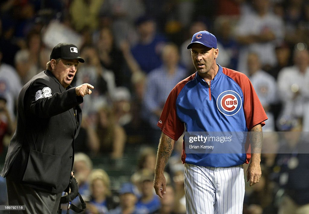 Manager Dale Sveum of the Chicago Cubs walks back to the dugout after he was ejected by home plate umpire Joe West during the second inning against...