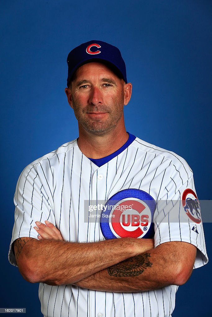Manager Dale Sveum #33 poses during Chicago Cubs photo day on February 18, 2013 at HoHoKam Park in Mesa, Arizona.