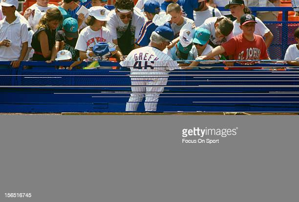 Manager Dallas Green of the New York Mets signs autographs for fans before the start of a Major League Baseball game circa 1995 at Shea Stadium in...