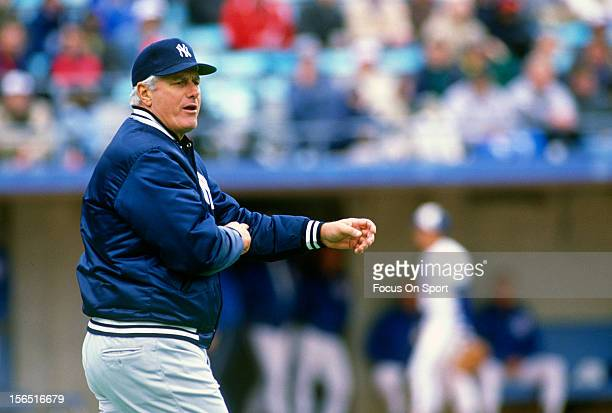 Manager Dallas Green of the New York Yankees signals the bullpen to make a pitching change during an Major League Baseball game circa 1989 Green...