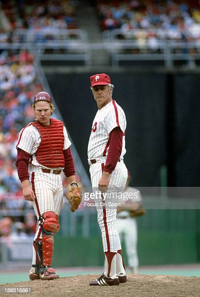 Manager Dallas Green of the Philadelphia Phillies making a pitching change stands on the mound talking with his catcher Keith Moreland during an...