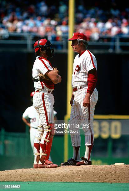 Manager Dallas Green of the Philadelphia Phillies making a pitching change stands on the mound talking with his catcher Bob Boone during an Major...