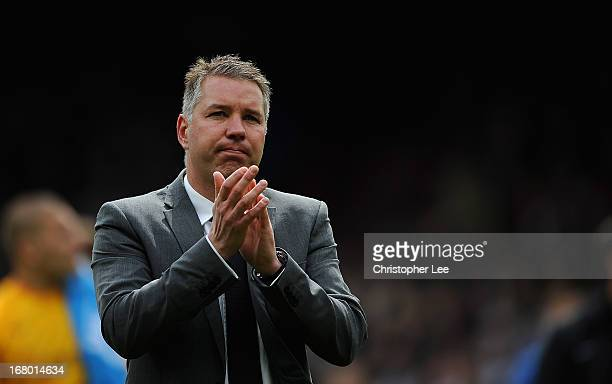 Manager Darren Ferguson of Peterborough looks dejected as he appaulds their fans during the npower Championship match between Crystal Palace and...