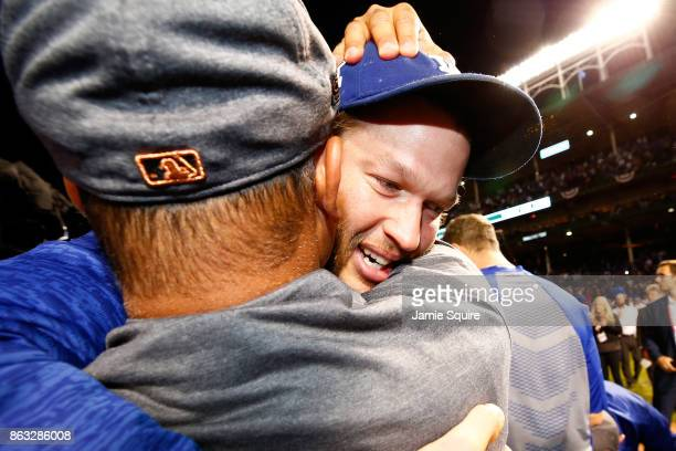 Manager Dave Roberts and Clayton Kershaw of the Los Angeles Dodgers celebrate after beating the Chicago Cubs 111 in game five of the National League...