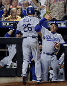 Manager Dave Roberts of the Los Angeles Dodgers congratulates his player Chase Utley after Utley hit a grand slam in the seventh inning against the...
