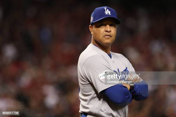 Manager Dave Roberts of the Los Angeles Dodgers looks on before the start of the National League Divisional Series game three against the Arizona...
