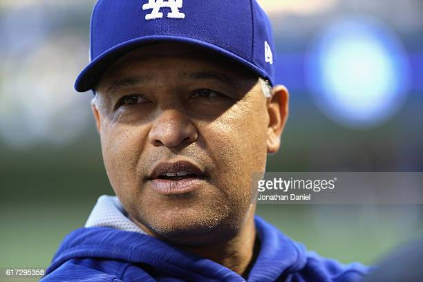 Manager Dave Roberts of the Los Angeles Dodgers looks on prior to game six of the National League Championship Series against the Chicago Cubs at...