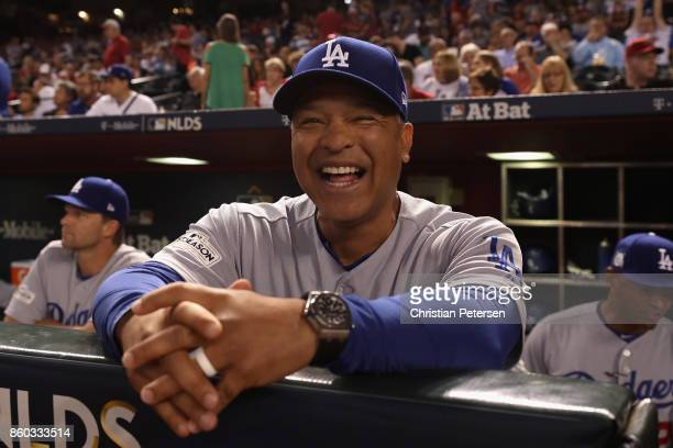 Manager Dave Roberts of the Los Angeles Dodgers reacts during the National League Divisional Series game three against the Arizona Diamondbacks at...