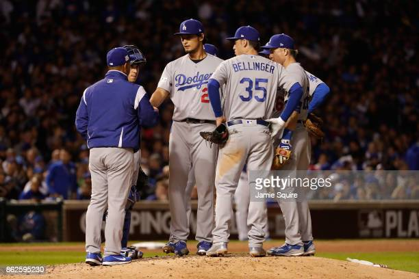 Manager Dave Roberts of the Los Angeles Dodgers relieves Yu Darvish in the seventh inning against the Chicago Cubs during game three of the National...