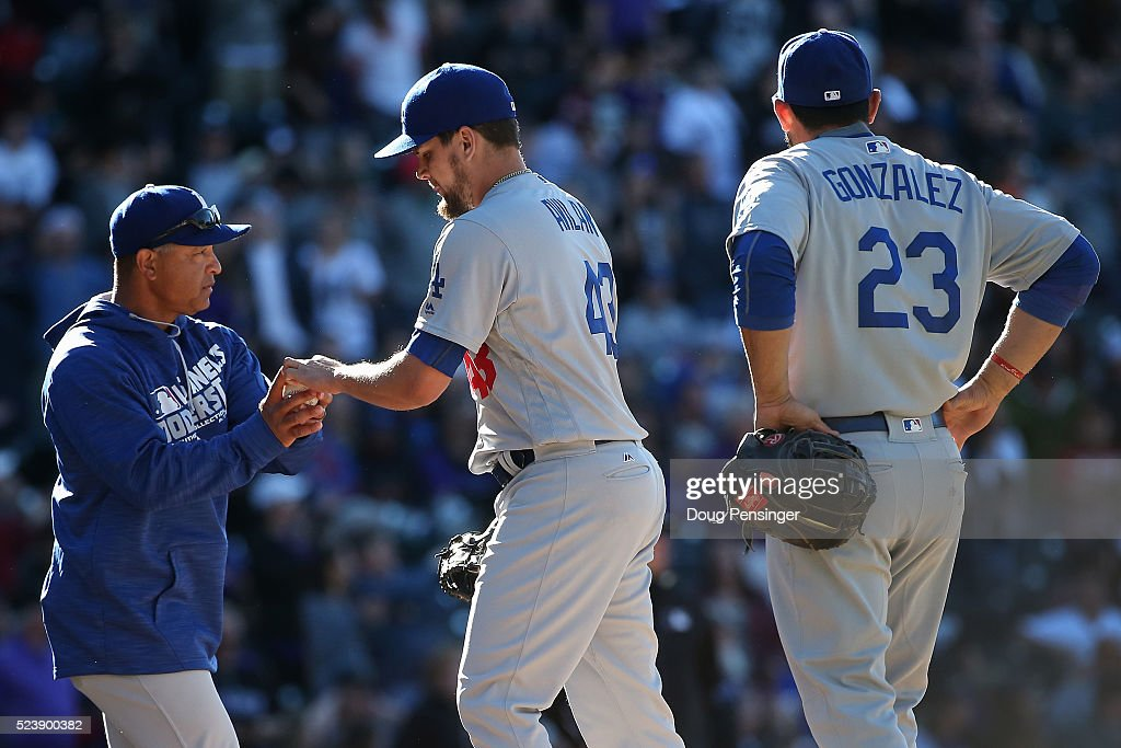 Manager Dave Roberts of the Los Angeles Dodgers removes pitcher Chris Hatcher from the game against the Colorado Rockies in the eighth inning as...
