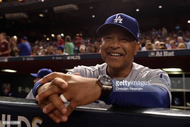 Manager Dave Roberts of the Los Angeles Dodgers smiles before the start of the National League Divisional Series game three against the Arizona...