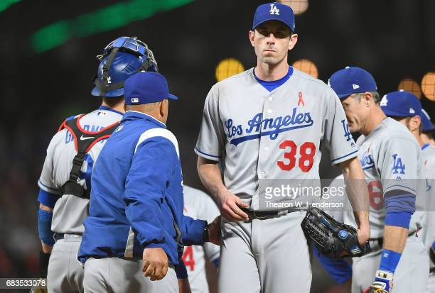 Manager Dave Roberts of the Los Angeles Dodgers takes the ball from starting pitcher Brandon McCarthy taking McCarthy out of the game against the San...