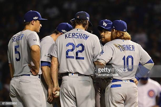 Manager Dave Roberts of the Los Angeles Dodgers visits Clayton Kershaw on the pitcher's mound during game two of the National League Championship...