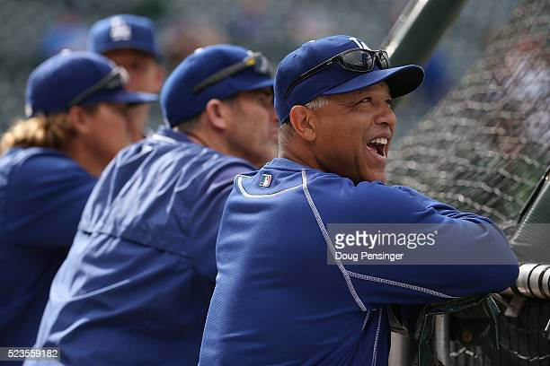 Manager Dave Roberts of the Los Angeles Dodgers watches batting practice prior to facing the Colorado Rockies at Coors Field on April 23 2016 in...