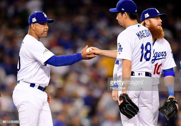 Manager Dave Roberts takes Kenta Maeda of the Los Angeles Dodgers out of the game against the Chicago Cubs during the seventh inning in Game One of...