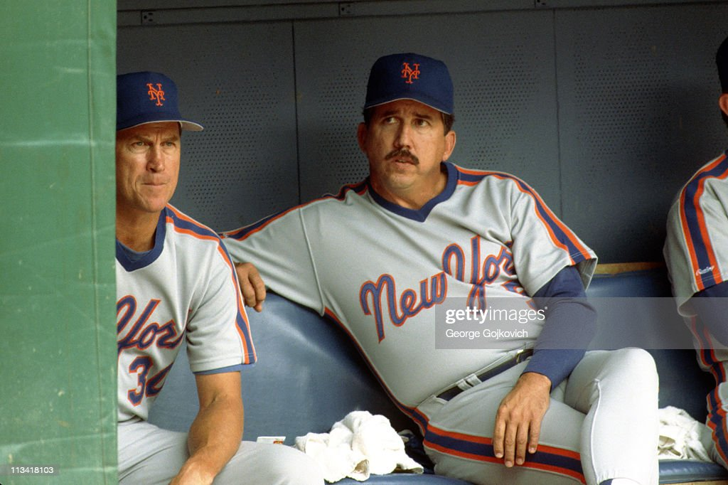 Manager Davey Johnson and pitching coach Mel Stottlemyre of the New York Mets look on from the dugout during a game against the Pittsburgh Pirates at...