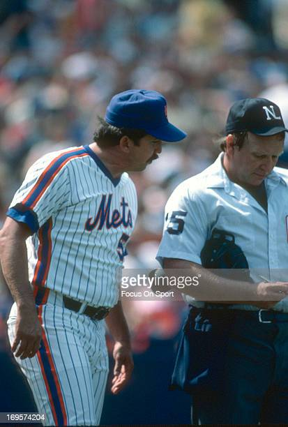 Manager Davey Johnson of New York Mets makes changes to lineup with the home plate umpire during an Major League Baseball game circa 1985 at Shea...