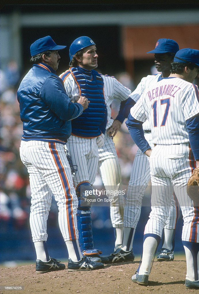 Manager Davey Johnson of New York Mets stands on the mound to make a pitching change during an Major League Baseball game circa 1987 at Shea Stadium...