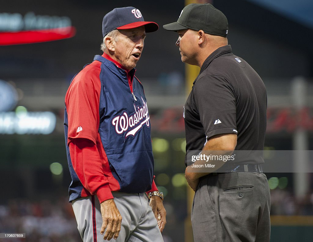 Manager <a gi-track='captionPersonalityLinkClicked' href=/galleries/search?phrase=Davey+Johnson+-+Baseball+Manager&family=editorial&specificpeople=93273 ng-click='$event.stopPropagation()'>Davey Johnson</a> #5 of the Washington Nationals argues a call with first base umpire Mark Carlson #6 during the sixth inning against the Cleveland Indians at Progressive Field on June 15, 2013 in Cleveland, Ohio.