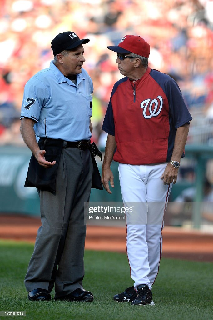 Manager Davey Johnson #5 of the Washington Nationals argues a call with home plate umpire John Hirschbeck during the fourth inning of a game against the Philadelphia Phillies at Nationals Park on August 11, 2013 in Washington, DC.
