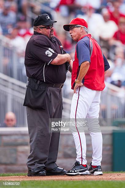 Manager Davey Johnson of the Washington Nationals argues with Home plate umpire Wally Bell during a game against the St Louis Cardinals at Nationals...