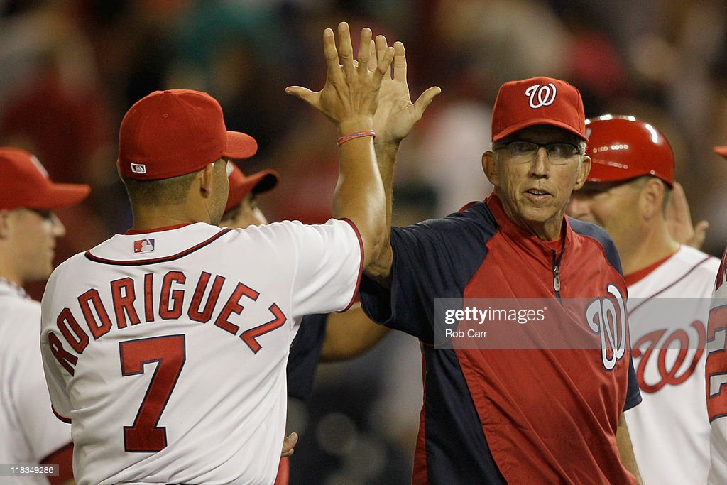 Manager Davey Johnson of the Washington Nationals celebrates the Nationals 54 win over the Chicago Cubs with catcher Ivan Rodriguez at Nationals Park...