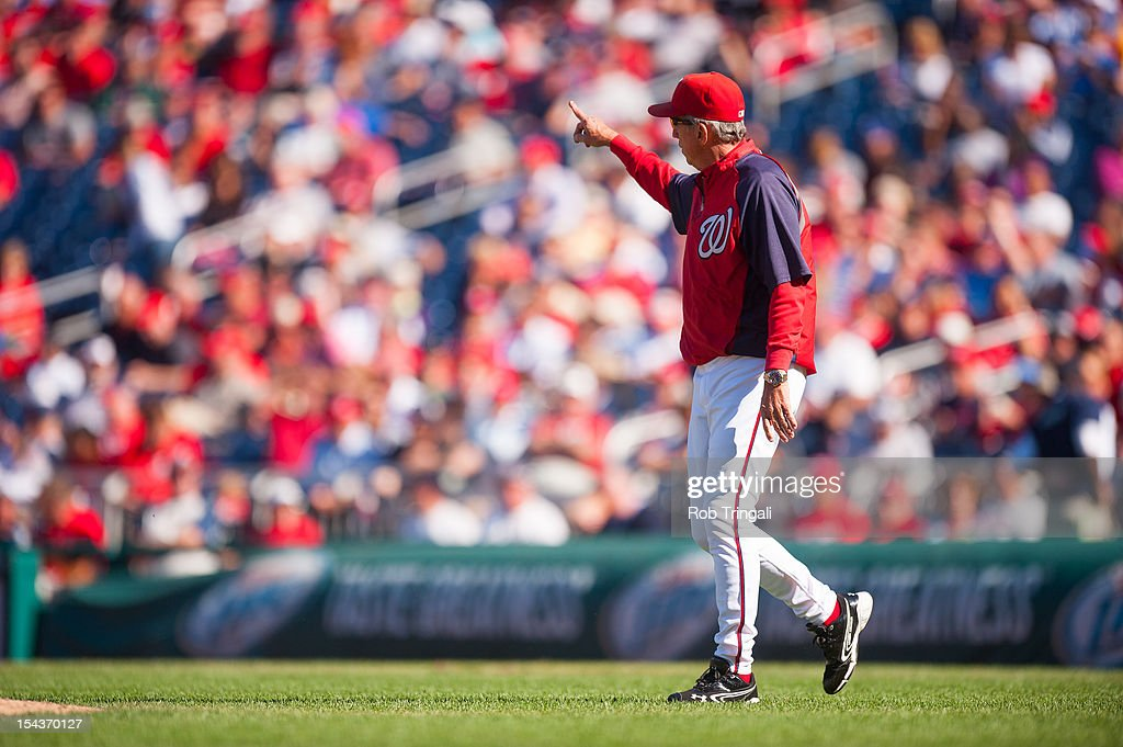 Manager Davey Johnson of the Washington Nationals gestures for a new pitcher during the game against the Milwaukee Brewers at Nationals Park on...
