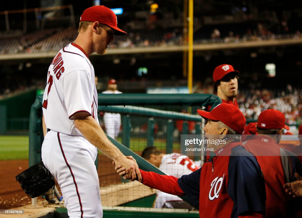 Manager Davey Johnson (R) of the Washington Nationals greets starter <a gi-track='captionPersonalityLinkClicked' href=/galleries/search?phrase=Stephen+Strasburg&family=editorial&specificpeople=6164496 ng-click='$event.stopPropagation()'>Stephen Strasburg</a> #37 (L) as he enters the dugout after finishing his night's work against the Miami Marlins at the end of the sixth inning of game 2 of their day-night doubleheader at Nationals Park on September 22, 2013 in Washington, DC. The Nationals won the game, 5-4.