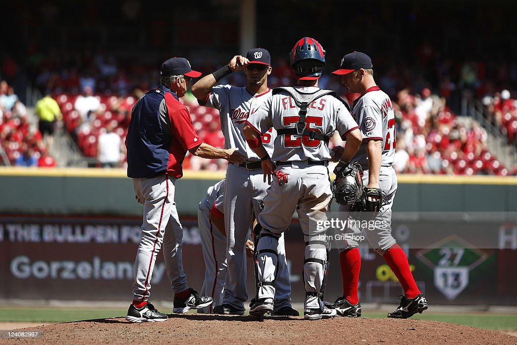 Manager Davey Johnson of the Washington Nationals makes a pitching change during the game against the Cincinnati Reds on August 28 2011 at Great...