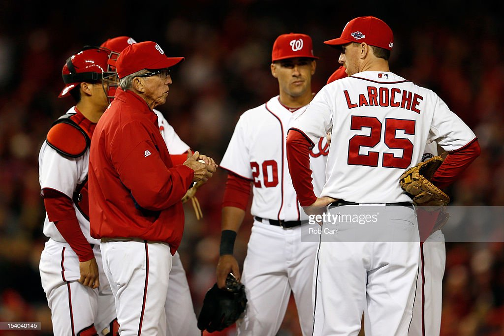 Manager Davey Johnson of the Washington Nationals makes a pitching change in the sixth inning while taking on the St Louis Cardinals in Game Five of...