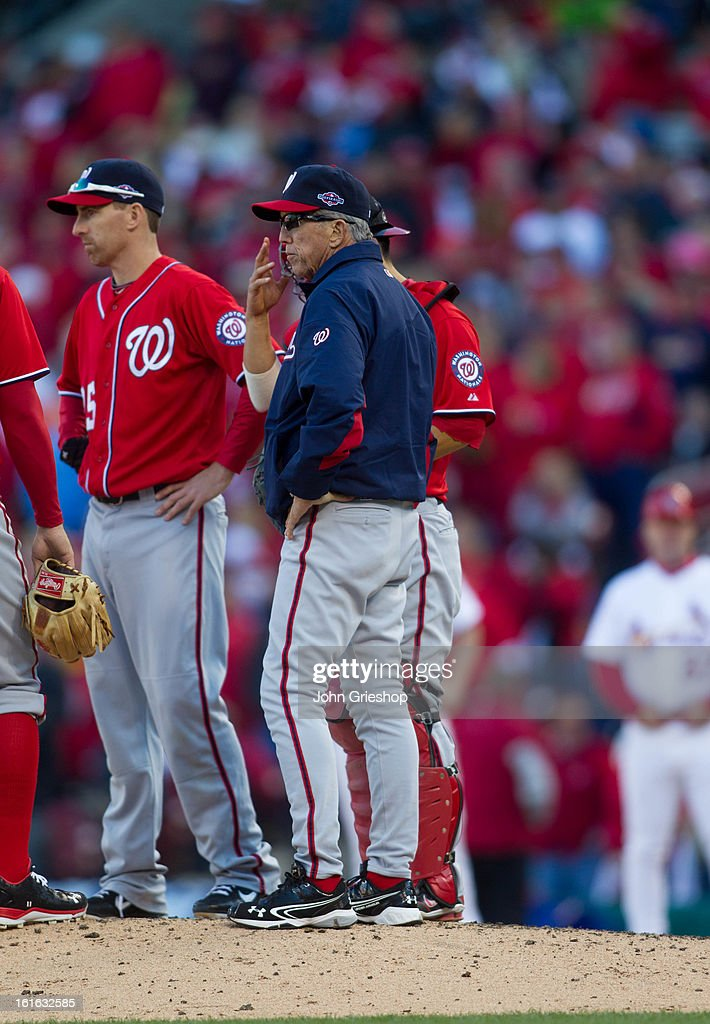 Manager Davey Johnson of the Washington Nationals makes a pitching change during Game 1 of the National League Division Series against the St Louis...