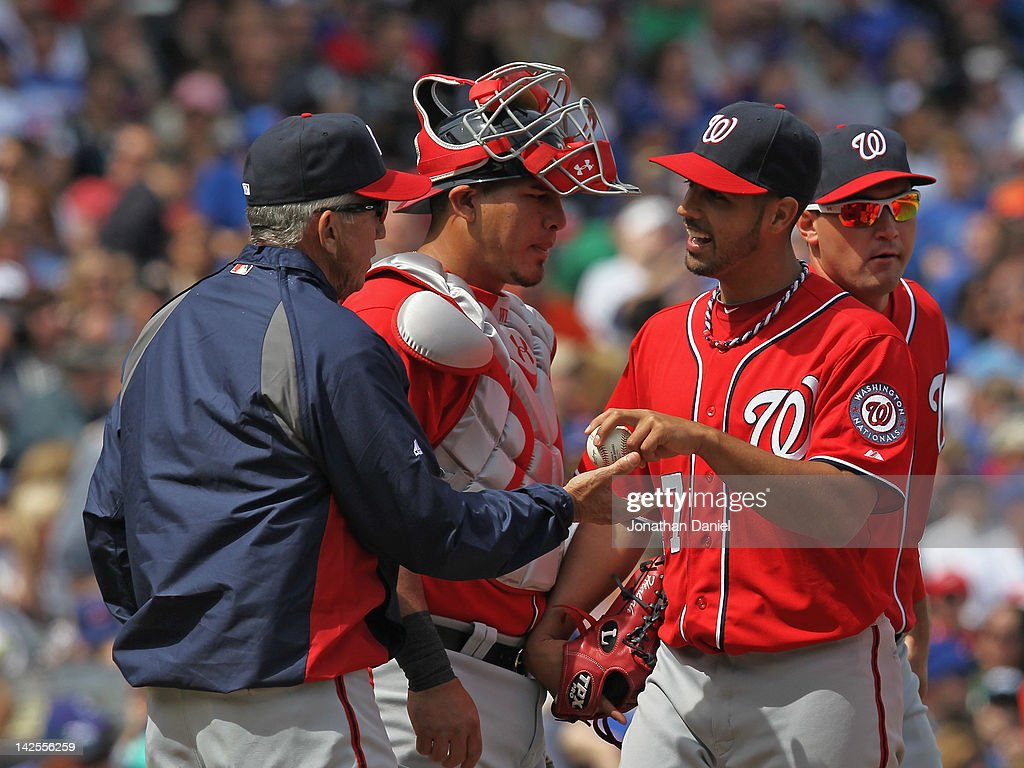 Manager Davey Johnson of the Washington Nationals takes starting pitcher Gio Gonzalez out of a game against the Chicago Cubs as Wilson Ramos watches...