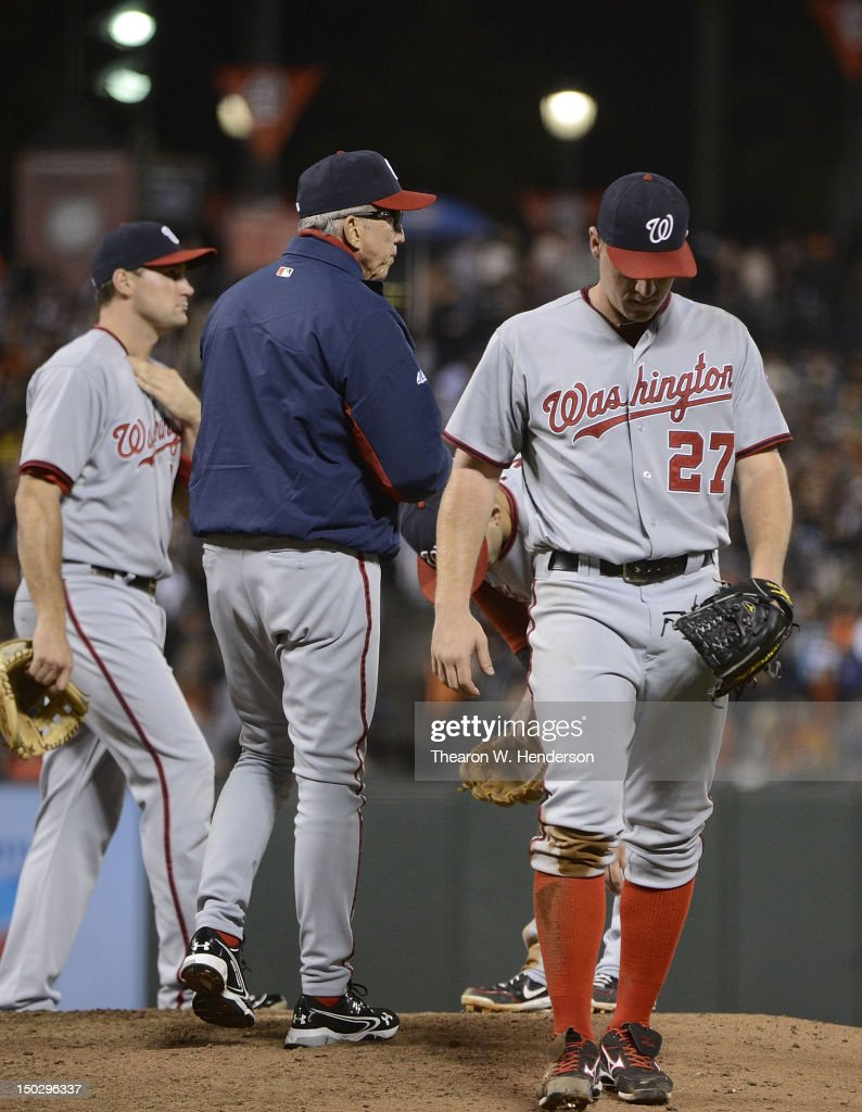 Manager Davey Johnson of the Washington Nationals takes the ball from pitcher Jordan Zimmermann taking him out of the game in the six inning against...