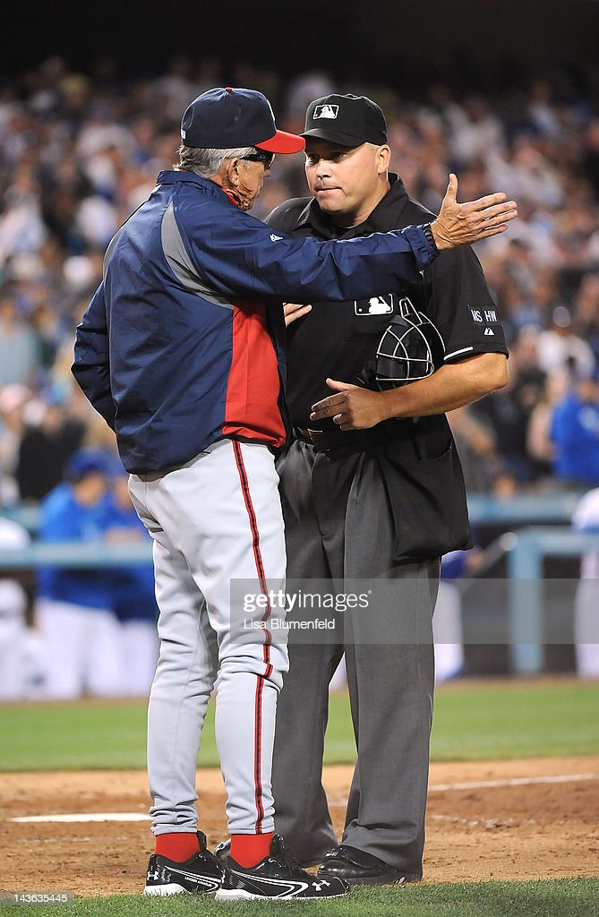Manager Davey Johnson of the Washington Nationals talks to umpire Mark Carlson during the game against the Los Angeles Dodgers at Dodger Stadium on...