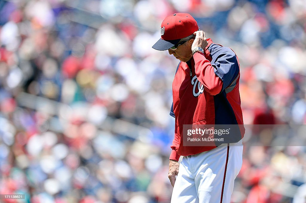 Manager Davey Johnson of the Washington Nationals walks off the field after pulling starting pitcher Dan Haren in the fourth inning during a game...