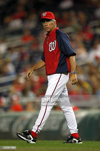 Manager Davey Johnson of the Washington Nationals walks to the mound against the Florida Marlins at Nationals Park on July 27 2011 in Washington DC...