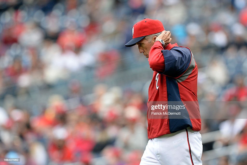 Manager Davey Johnson of the Washington Nationals walks to the pitcher's mound to make a pitching change during a game against the Cincinnati Reds at...