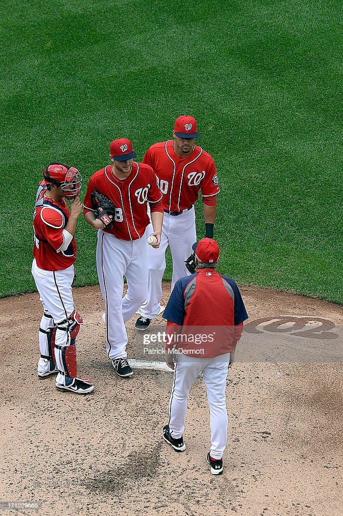 Manager Davey Johnson of the Washington Nationals walks to the pitcher's mound to pull Ross Detwiler in the fourth inning during a game against the...