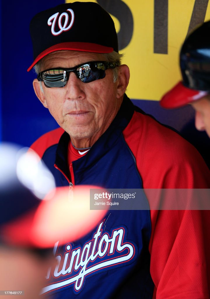 Manager Davey Johnson #5 of the Washington Nationals watches from the dugout during the game against the Kansas City Royals at Kauffman Stadium on August 25, 2013 in Kansas City, Missouri.