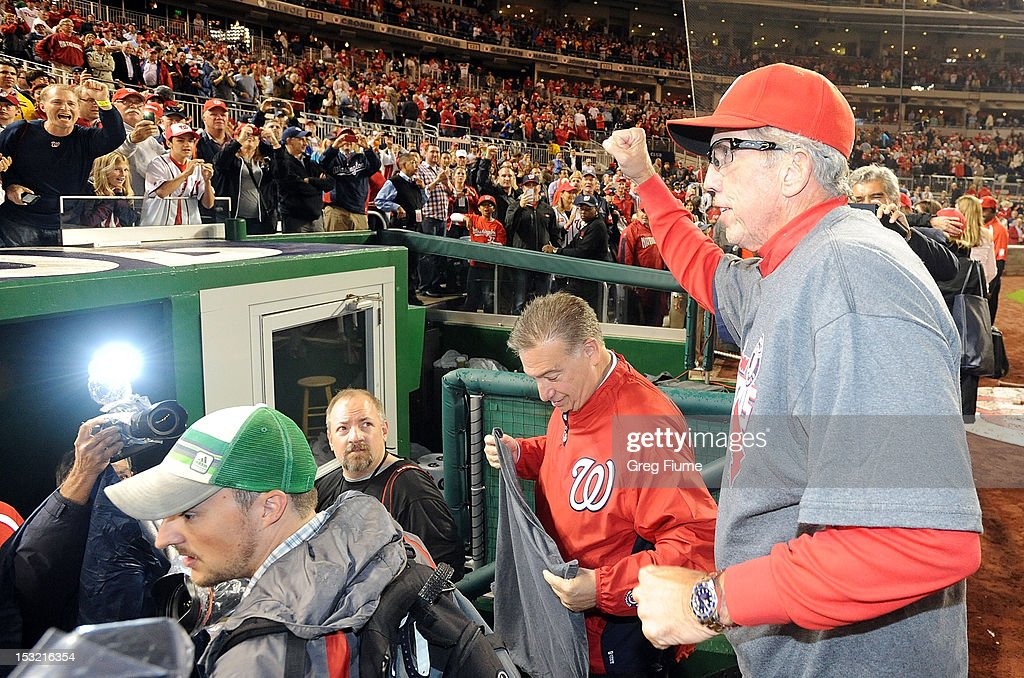 Manager <a gi-track='captionPersonalityLinkClicked' href=/galleries/search?phrase=Davey+Johnson+-+Baseball+Manager&family=editorial&specificpeople=93273 ng-click='$event.stopPropagation()'>Davey Johnson</a> #5 of the Washington Nationals waves to the crowd after winning the National League East Division Championship after the game against the Philadelphia Phillies at Nationals Park on October 1, 2012 in Washington, DC.