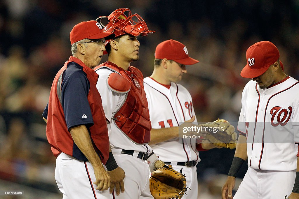 Manager Davey Johnson on the mound during a pitching change against the Chicago Cubs at Nationals Park on July 7 2011 in Washington DC