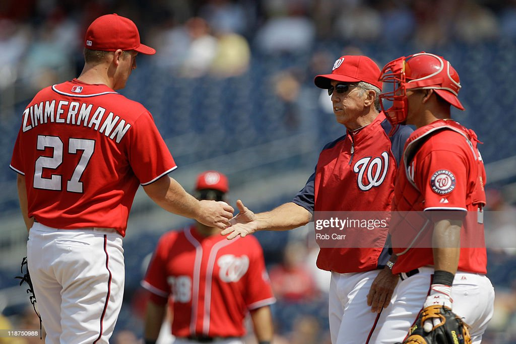 Manager Davey Johnson takes the ball from starting pitcher Jordan Zimmermann of the Washington Nationals as catcher Wilson Ramos looks on during the...