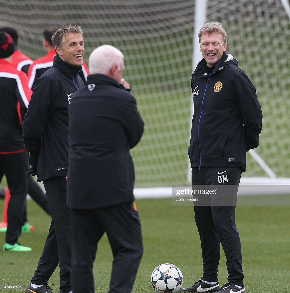 Manager <a gi-track='captionPersonalityLinkClicked' href=/galleries/search?phrase=David+Moyes&family=editorial&specificpeople=215482 ng-click='$event.stopPropagation()'>David Moyes</a> and Coach <a gi-track='captionPersonalityLinkClicked' href=/galleries/search?phrase=Phil+Neville&family=editorial&specificpeople=201898 ng-click='$event.stopPropagation()'>Phil Neville</a> of Manchester United in action during a first team training session, ahead of their UEFA Champions League Round of 16 match against Olympiacos, at Aon Training Complex on February 24, 2014 in Manchester, England.