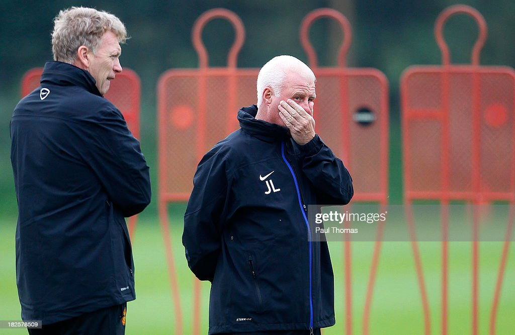 Manager David Moyes and first team coach Jimmy Lumsden (R) of Manchester United watch players in action during a training session ahead of their Champions League Group A match against Shakhtar Donetsk at their Carrington Training Complex on October 01, 2013 in Manchester, England
