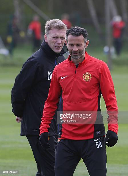 Manager David Moyes and Ryan Giggs of Manchester United in action during a first team training session ahead of their UEFA Champions League...