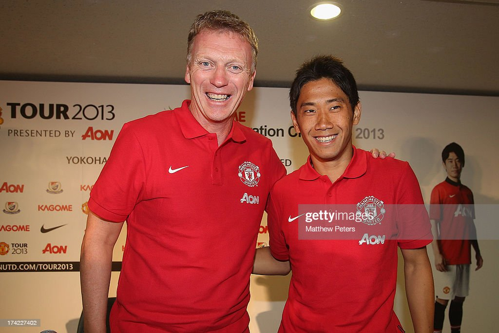 Manager <a gi-track='captionPersonalityLinkClicked' href=/galleries/search?phrase=David+Moyes&family=editorial&specificpeople=215482 ng-click='$event.stopPropagation()'>David Moyes</a> and <a gi-track='captionPersonalityLinkClicked' href=/galleries/search?phrase=Shinji+Kagawa&family=editorial&specificpeople=4314029 ng-click='$event.stopPropagation()'>Shinji Kagawa</a> of Manchester United pose after a press conference as part of their pre-season tour of Bangkok, Australia, China, Japan and Hong Kong on July 22, 2013 in Yokohama, Japan.