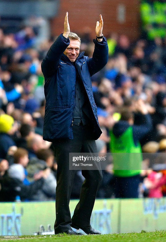 Manager <a gi-track='captionPersonalityLinkClicked' href=/galleries/search?phrase=David+Moyes&family=editorial&specificpeople=215482 ng-click='$event.stopPropagation()'>David Moyes</a> of Everton celebrates his team's second goal during the Barclays Premier League match between Everton and West Ham United at Goodison Park on May 12, 2013 in Liverpool, England.