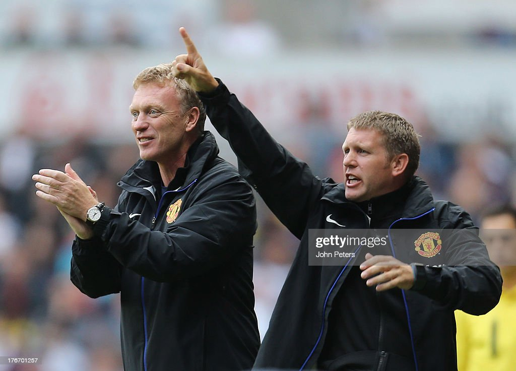 Manager <a gi-track='captionPersonalityLinkClicked' href=/galleries/search?phrase=David+Moyes&family=editorial&specificpeople=215482 ng-click='$event.stopPropagation()'>David Moyes</a> (L) of Manchester United celebrates Robin van Persie scoring their third goal during the Barclays Premier League match between Swansea City and Manchester United at the Liberty Stadium on August 17, 2013 in Swansea, Wales.