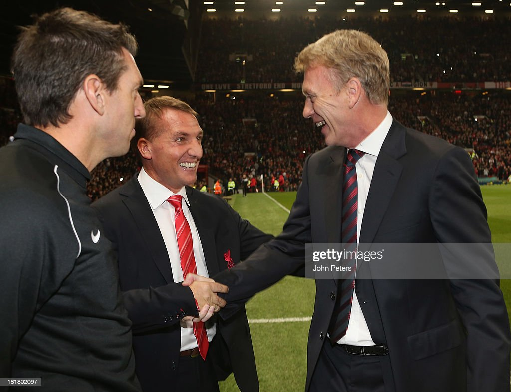 Manager David Moyes of Manchester United greets Brendan Rodgers of Liverpool ahead of the Capital Cup Third Round match between Manchester United and Liverpool at Old Trafford on September 25, 2013 in Manchester, England.
